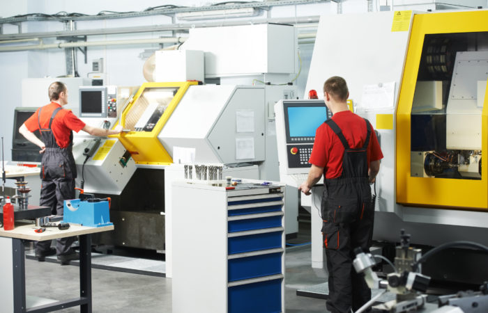 Mechanical Technicians Working At Cnc Milling Machine Center In Tool Workshop